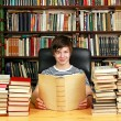 Teenager in library — Stock Photo #10636194