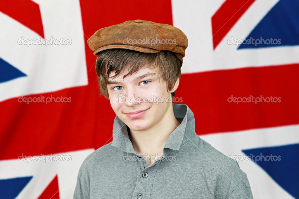 Young British boy with hat in front of Union Jack national flag  Stock Photo #10636183