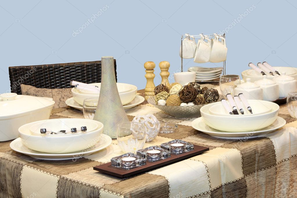 Retro table setting with ceramic plates and cotton tablecloth  Stock Photo #8700630