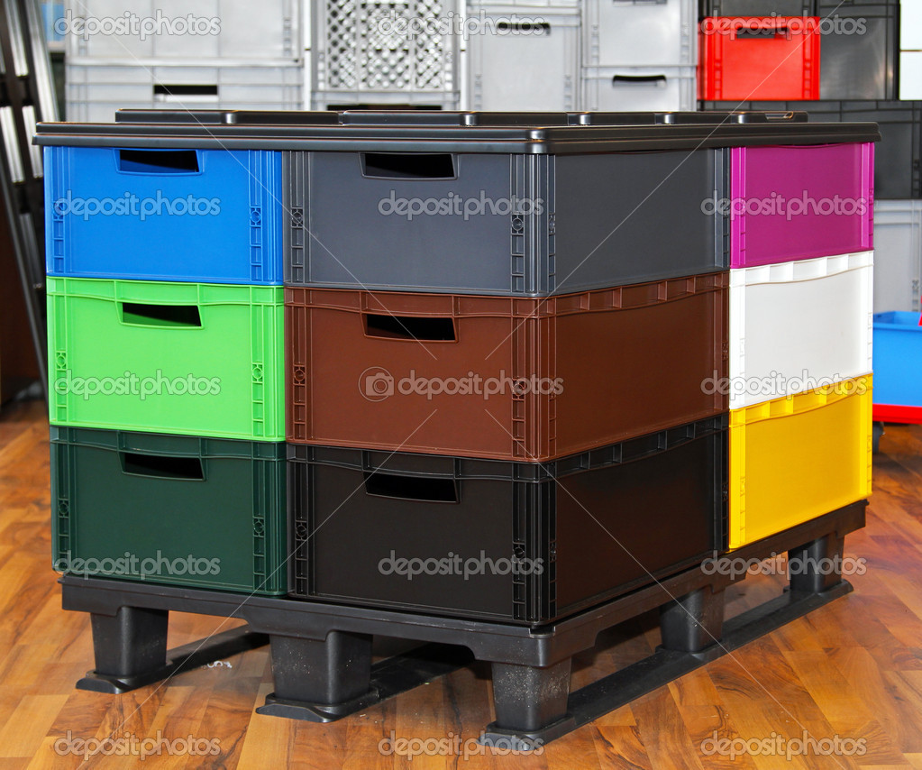 Color plastic crates and boxes at transportation pallet — Stock Photo #8714237