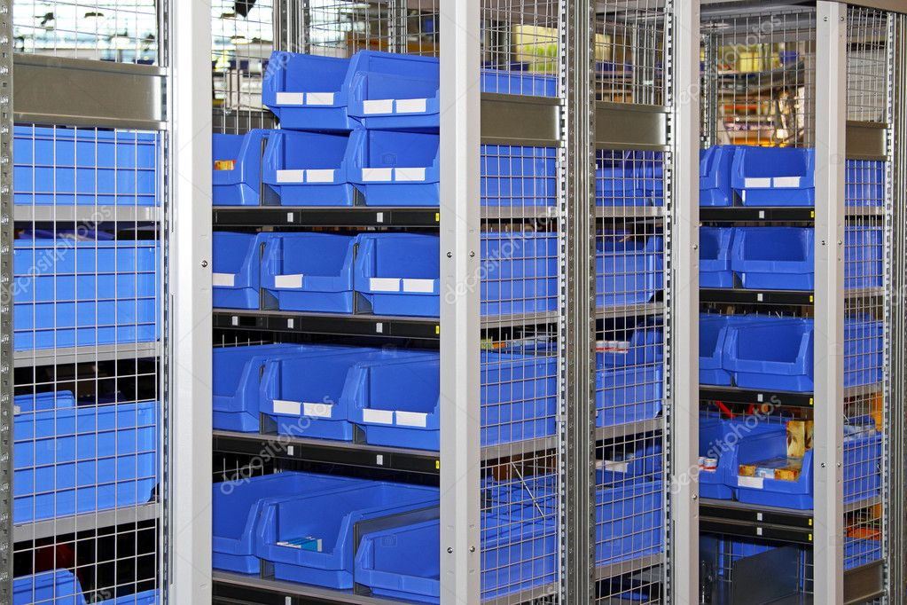 Blue plastic sort boxes in shelf  Lizenzfreies Foto #8714291
