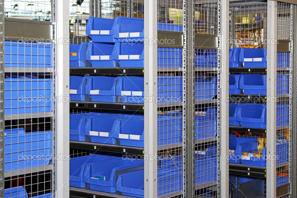 Blue plastic sort boxes in shelf — Foto Stock #8714291