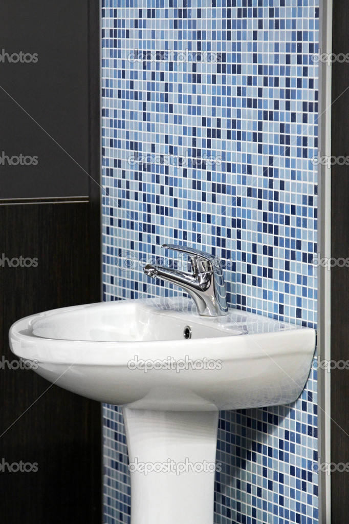 Sink bowl in bathroom with blue tiles — Stock Photo #9209245