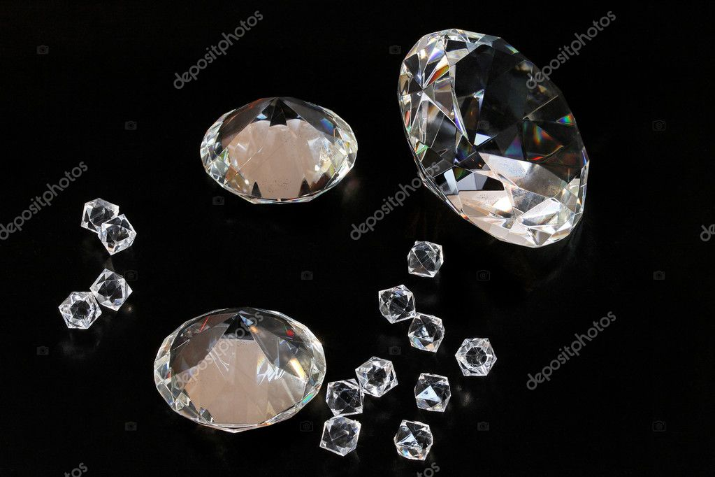 Several gems and diamonds at black background — Stock Photo #9894589