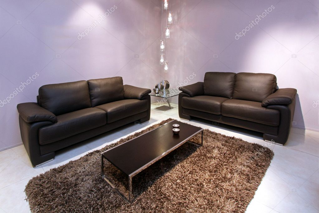 Corner of living room with brown leather furniture  Stock Photo #9914329