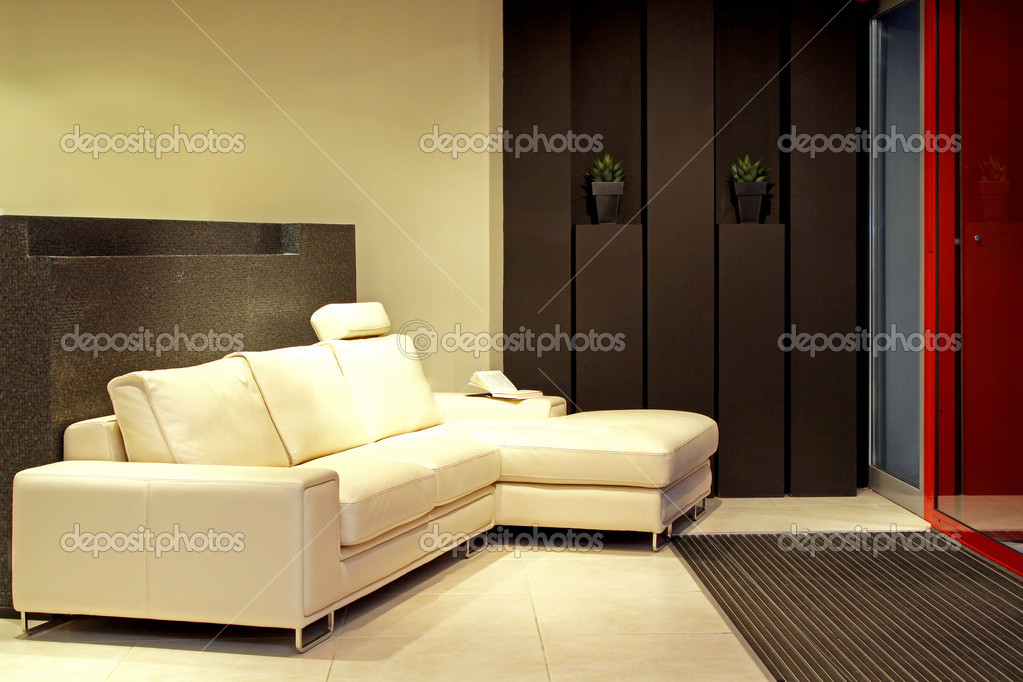 White leather corner sofa in modern interior  Stock Photo #9914369