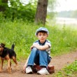 Stock Photo: The boy with his dog in the forest