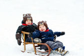 Boys in the sled — Stock Photo