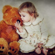 Little girl and teddy bear — Stock Photo #9485997