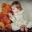 Stock Photo: Little girl and teddy bear