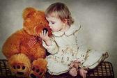 Little girl and teddy bear — Stock Photo
