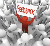 Uomo di feedback con il cartello in folla condivisione parere — Foto Stock