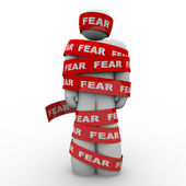 Scared Afraid Man Wrapped in Red Fear Tape — Stock Photo