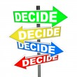Stock Photo: Decide Words on Colorful Arrow Signs Different Directions