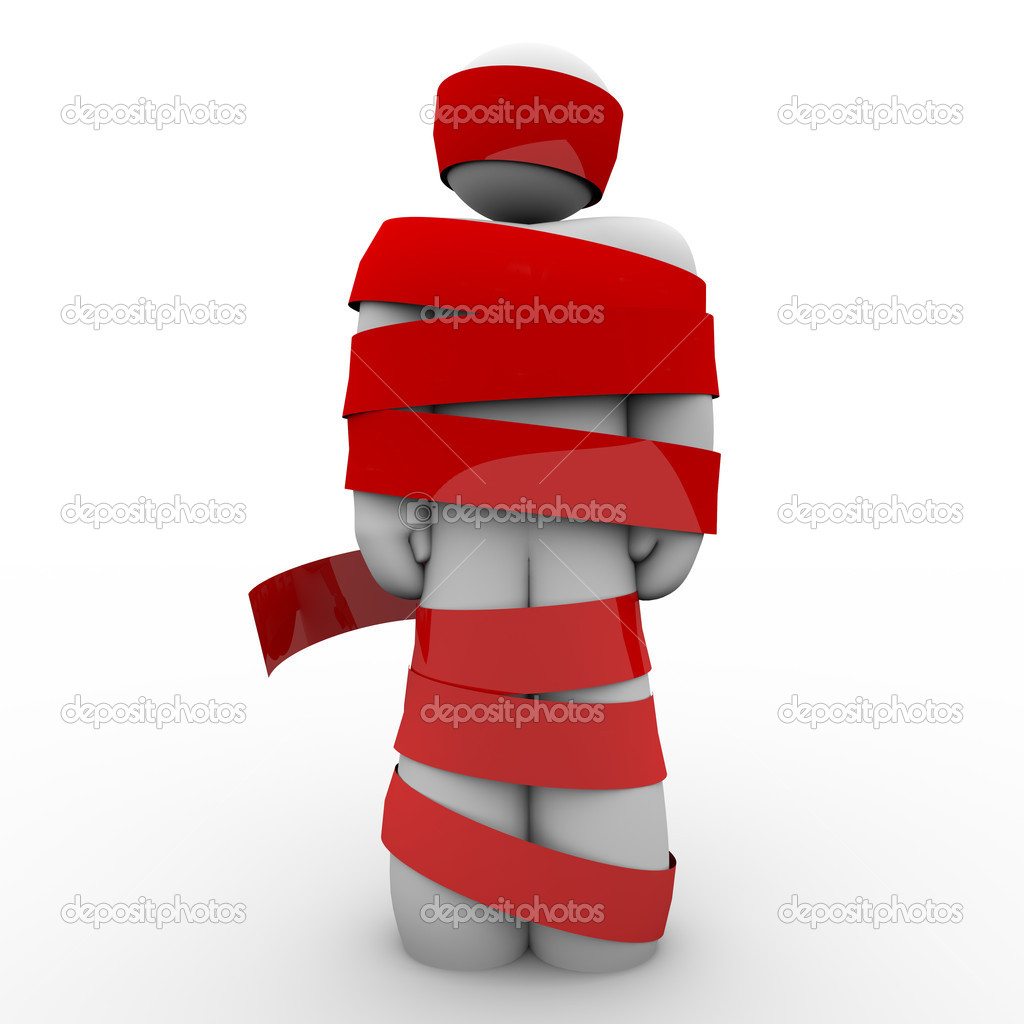 A man is wrapped in red tape representing being immobolized due to bureaucracy, kidnapping, fear or other concept keeping him from moving or acting — Stock Photo #9056991