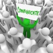 Communicate Person Holds Sign Get Attention of Crowd — Stock Photo #9687357