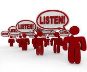 Escucha - muchos hablando exigente atención — Foto de Stock