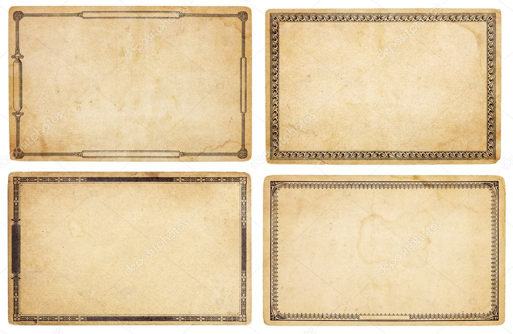 A set of four heavily aged, blank cards with stains, creases and tears.  Each card has different, old-fashioned decorative border. Isolated on white. Includes c — Stock Photo #8569537