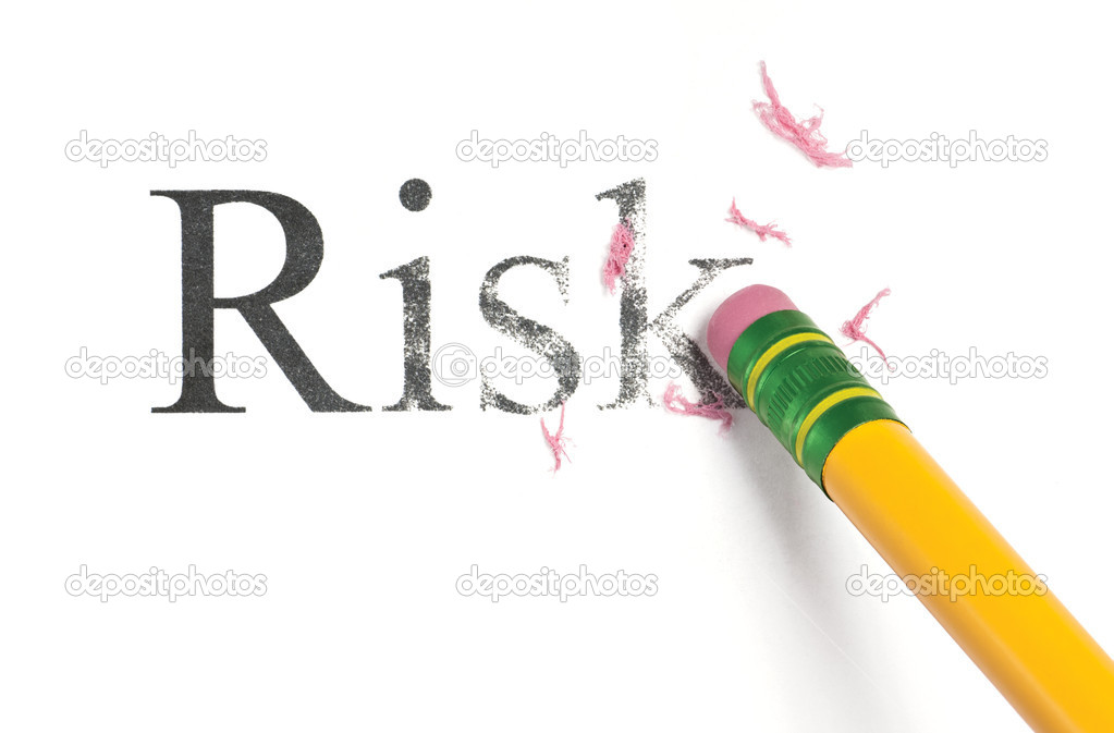 Close up of a yellow pencil erasing the word, 'Risk.' Isolated on white.  Stock Photo #9464056