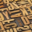 Antique wood alphabet abstract — Foto Stock