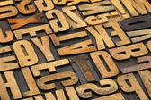 Antique wood alphabet abstract — Stock Photo