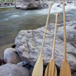 Stock Photo: Canoe paddles and river