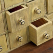 Stock Photo: Vintage apothecary drawer cabintet
