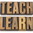 Teach. learn - words in wood type — Stockfoto #10622662