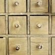 Stock Photo: Primitive apothecary drawer cabinet