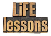 Life lessons - text in wood type — Stock Photo