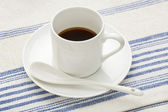 Espresso coffee cup with spoon — Stock Photo