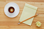 Empty coffee cup and notepad — Stock Photo