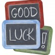 Good luck wishes on blackboard — Stock Photo