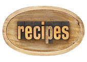 Recipes word in wooden bowl — Stock Photo