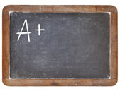 A plus grade on blackboard — Foto Stock