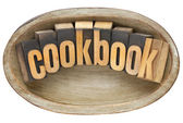 Cookbook in wooden bowl — Stock Photo