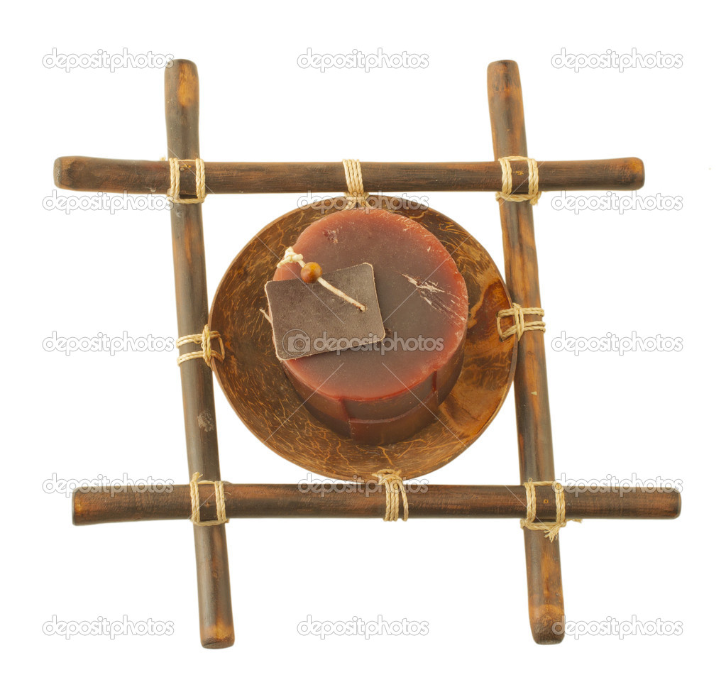 Brown candle over wooden decoration object, seen from above  Foto Stock #10058630