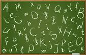 Tableau noir avec les lettres de l'alphabet dans l'ordre chaotique — Vecteur