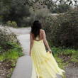 Young Woman Walking in Yellow Dress Outdoors — Stock Photo