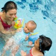 Happy asian mother teach baby to swim — Stock Photo