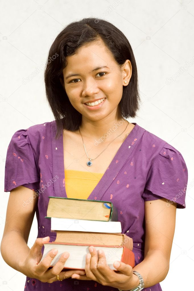 Portrait of Asian female student with stack of literature on hands. isolate on white — Stock Photo #8778901