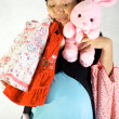 Pregnant woman with child clothing and bunny doll — Stock Photo