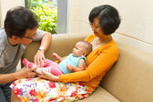 Asian Grandparent babysit a baby — Stock Photo