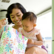Mother and baby with shopping bag — Stock Photo #8813601
