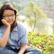 Contemplating asian school girl — Stock Photo #8814054