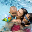 Asian mother and children swim together — Stock Photo #8814096