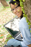 Attractive female college student with laptop — Stock Photo