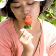 Asian woman loves strawberry — Stock Photo