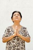 Asian old woman praying — Stock Photo