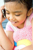 Asian ethnic little girl with cellphone — Stock Photo